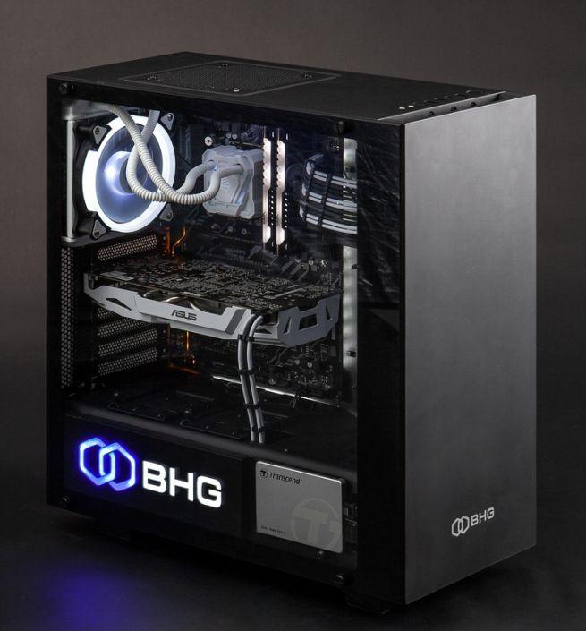 фото черного корпуса игрового компьютера со светящимся вентилятором охлаждения